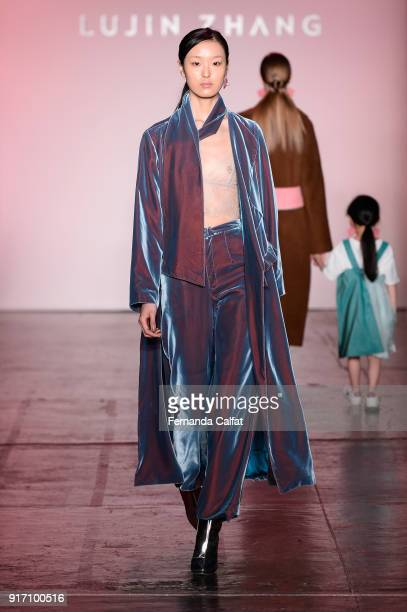 A model walks the runway for Lujin Zhang during New York Fashion Week The Shows at Industria Studios on February 11 2018 in New York City