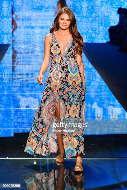A model walks the runway for Luli Fama during the Paraiso Fashion Fair at The Paraiso Tent on July 14 2018 in Miami Beach Florida