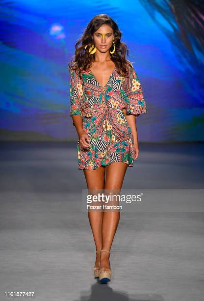 Model walks the runway for Luli Fama Fashion Show - Luli's Electric Jungle at The Paraiso Tent on July 13, 2019 in Miami Beach, Florida.