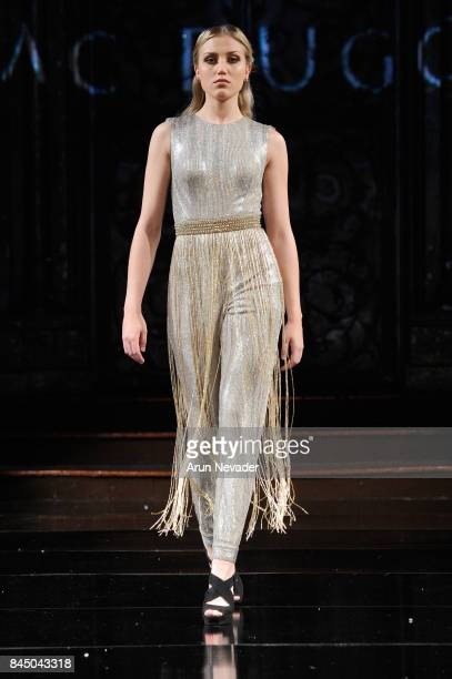 A model walks the runway for Mac Duggal at New York Fashion Week NYFW Art Hearts Fashion at The Angel Orensanz Foundation on September 9 2017 in New...