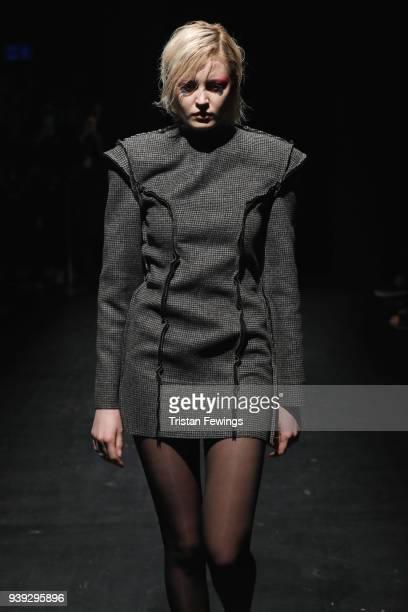 A model walks the runway for MercedesBenz presents Atelier Kikala show at Zorlu Performance Hall on March 28 2018 in Istanbul Turkey