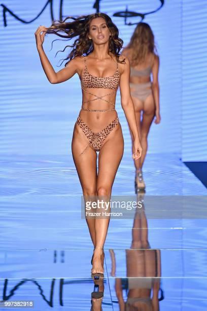 A model walks the runway for Monica Hansen during the Paraiso Fashion Fair at The Paraiso Tent on July 12 2018 in Miami Beach Florida
