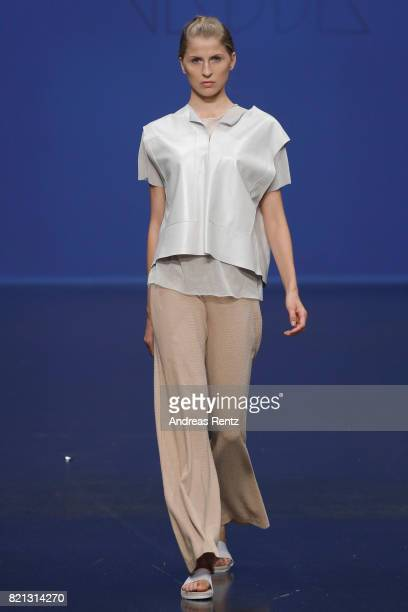 A model walks the runway for 'Nadja Kiess' at the PF Selected show during Platform Fashion July 2017 at Areal Boehler on July 23 2017 in Duesseldorf...