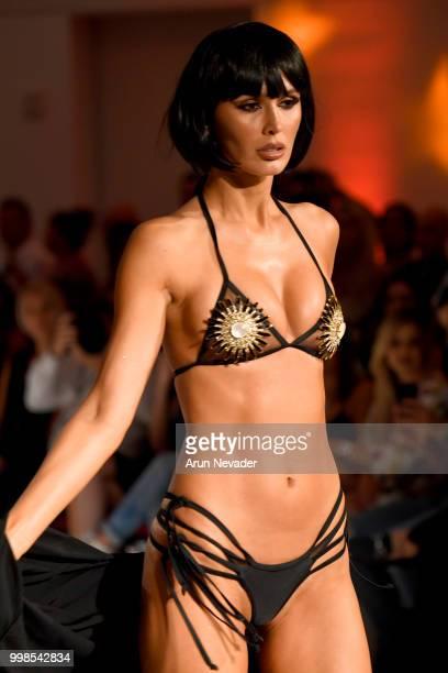 Model walks the runway for OMG Miami Swimwear at Miami Swim Week powered by Art Hearts Fashion Swim/Resort 2018/19 at Faena Forum on July 13, 2018 in...