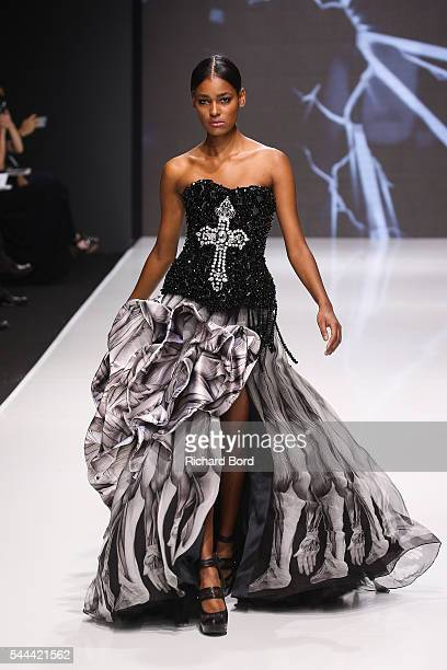 A model walks the runway for On Aura Tout Vu during the Couturissimo Fall/Winter 20162017 show as part of Paris Fashion Week on July 3 2016 in Paris...