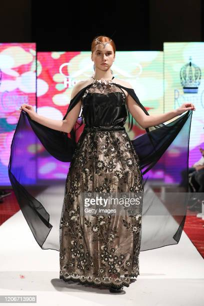 A model walks the runway for Royalty Couture Fashion at the House of iKons show at the Millennium Gloucester Hotel on February 16 2020 in London...