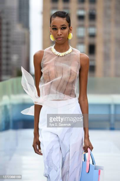 Model walks the runway for Salisa with jewelry by Tekne and handbags by Voila Concepts during the Flying Solo NYFW Show September 2020 at 433...