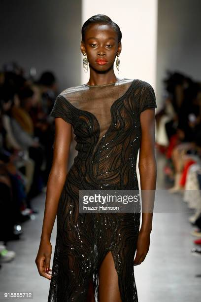 A model walks the runway for Tadashi Shoji during New York Fashion Week The Shows at Gallery I at Spring Studios on February 8 2018 in New York City