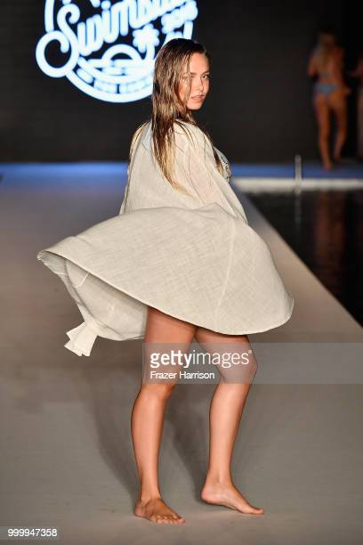 A model walks the runway for the 2018 Sports Illustrated Swimsuit show at PARAISO during Miami Swim Week at The W Hotel South Beach on July 15 2018...