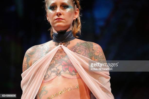 A model walks the runway for the AnaOno Intimates X Cancerland show at New York Fashion Week on February 12 2017 / AFP / KENA BETANCUR