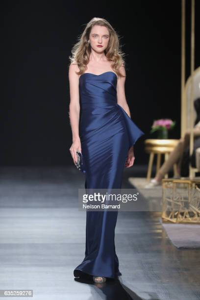 A model walks the runway for the Badgley Mischka collection during New York Fashion Week The Shows at Gallery 1 Skylight Clarkson Sq on February 14...