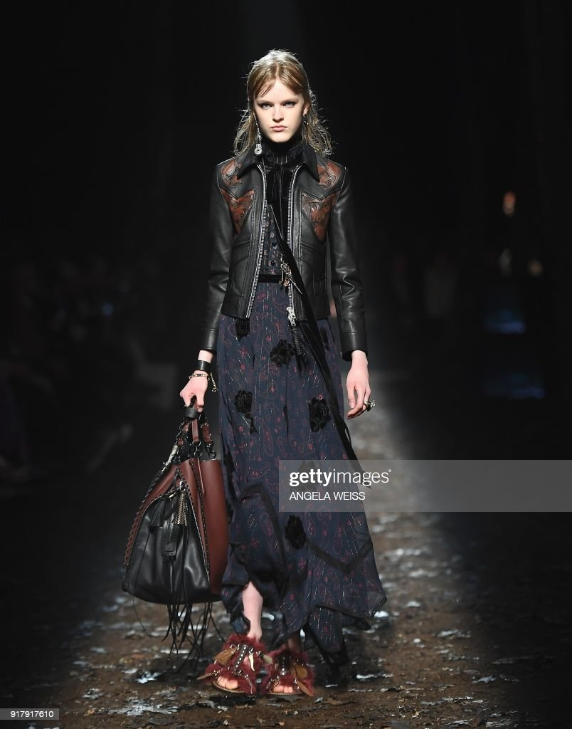 A model walks the runway for the Coach Fall 2018 Show at Basketball City on February 13, 2018 in New York City. /