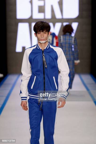 A model walks the runway for the DB Berdan show during Mercedes Benz Fashion Week Istanbul at Zorlu Center on March 28 2018 in Istanbul Turkey