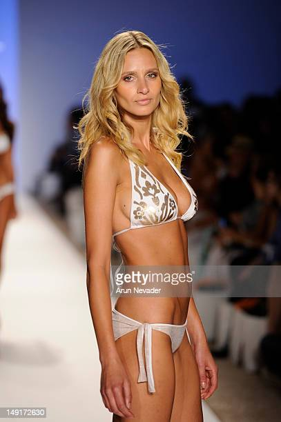 A model walks the runway for the Dorit collection during the Anna Kosturova Dorit Keva J Naila fashion show on July 23 2012 in Miami Beach Florida