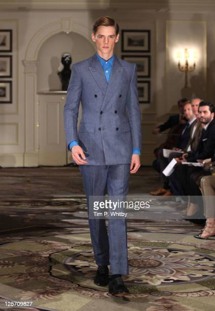 A model walks the runway for the ETautz show at London Fashion Week Spring/Summer 2012 at the Savoy Hotel on September 21 2011 in London England