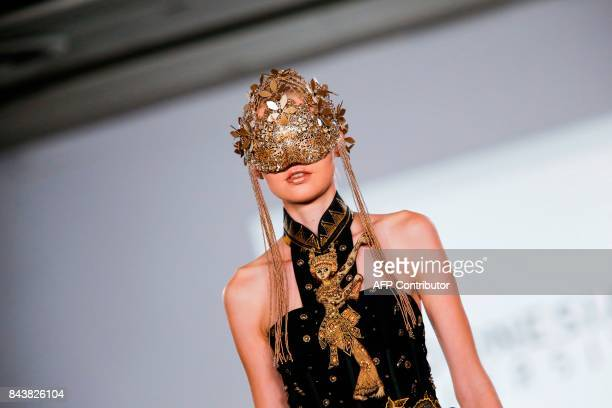 TOPSHOT A model walks the runway for the Indonesian Diversity show during New York Fashion Week on September 7 in New York / AFP PHOTO / EDUARDO...
