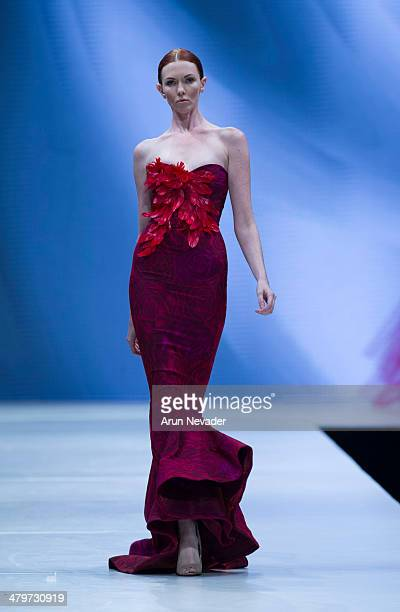A model walks the runway for the Irina Shabayeva fashion show during Project Runway at El Paseo Fashion Week 2014 on March 19 2014 in Palm Desert...