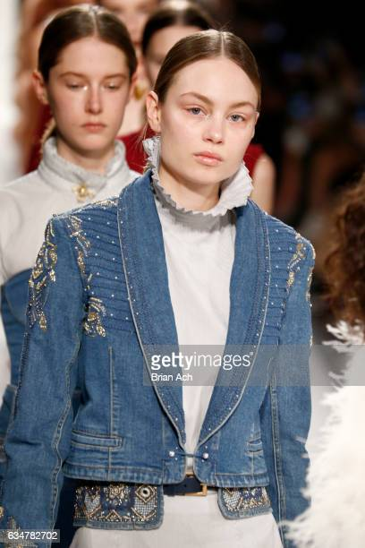 A model walks the runway for the Jonathan Simkhai collection during New York Fashion Week The Shows at Gallery 1 Skylight Clarkson Sq on February 11...