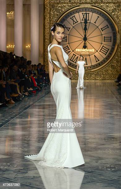 A model walks the runway for the latest collection by 'Pronovias' during Barcelona Bridal Week on May 8 2015 in Barcelona Spain