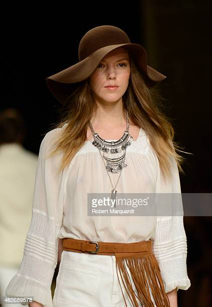 A model walks the runway for the Mango collection at the '080 Barcelona Fashion Week 2015 Fall/Winter' on February 2 2015 in Barcelona Spain