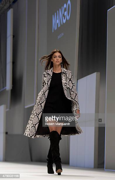A model walks the runway for the Mango fashion show at 'Barcelona 080 Fashion AutumnWinter 20152016' on June 29 2015 in Barcelona Spain