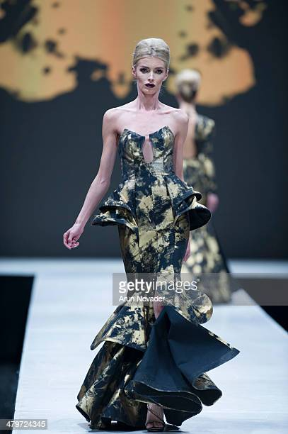A model walks the runway for the Michael Costello Couture fashion show fall 2014 during Project Runway at El Paseo Fashion Week 2014 on March 19 2014...