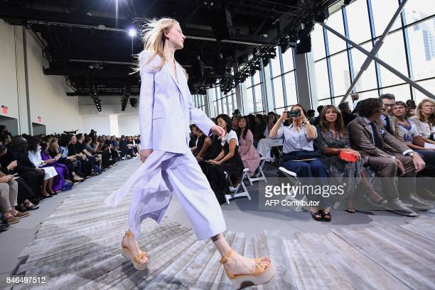A model walks the runway for the Michael Kors Collection Spring 2018 Runway Show at Spring Studios on September 13 during New York Fashion Week in...