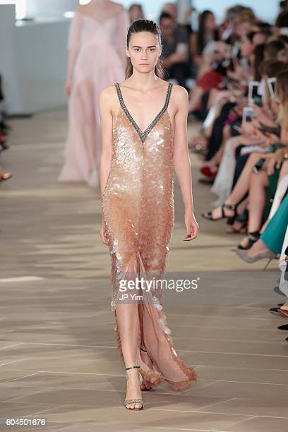 Model walks the runway for the Monique Lhuillier fashion show during New York Fashion Week September 2016 at The IAC Building on September 13, 2016...