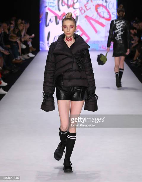 A model walks the runway for the Murat Aytulum show during Mercedes Benz Fashion Week Istanbul at Zorlu Performance Hall on March 30 2018 in Istanbul...