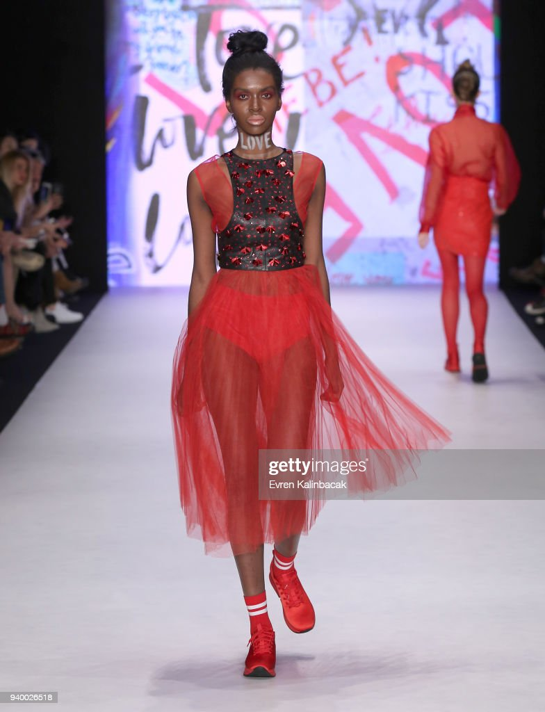 A model walks the runway for the Murat Aytulum show during Mercedes Benz Fashion Week Istanbul at Zorlu Performance Hall on March 30, 2018 in Istanbul, Turkey.