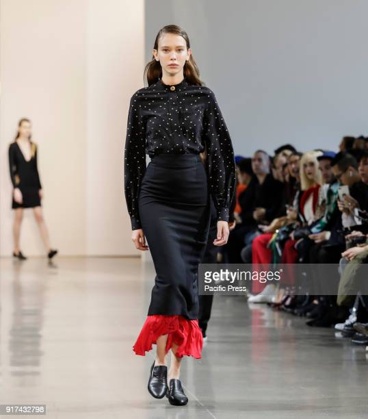 A model walks the runway for the Noon by Noor Fall/Winter 2018 runway show during New York Fashion Week at Spring Studios