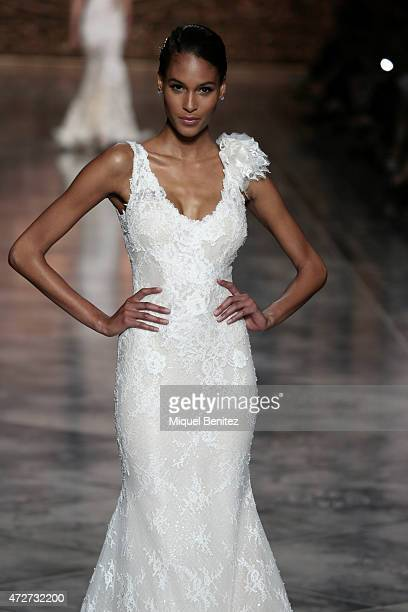 A model walks the runway for the Pronovias fashion show 2016 as part of the Barcelona Bridal Week at the Museu Nacional d'Art de Catalunya in...