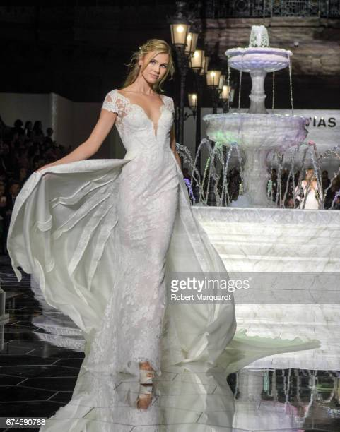 A model walks the runway for the Pronovias Show during Barcelona Bridal Fashion Week 2017 held at the Museu Nacional d'Art de Catalunya on April 28...