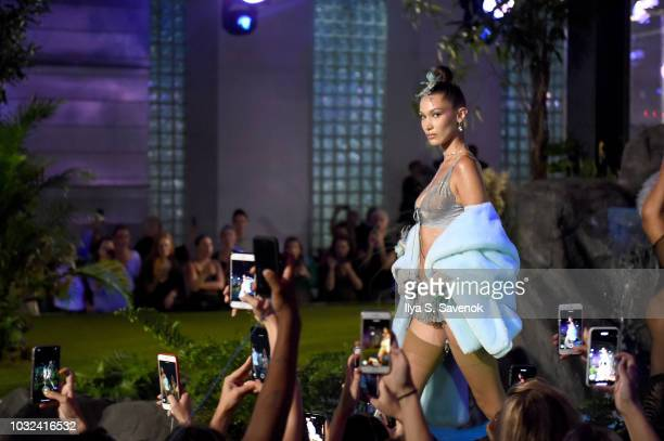 A model walks the runway for the Savage X Fenty Fall/Winter 2018 fashion show during NYFW at the Brooklyn Navy Yard on September 12 2018 in Brooklyn...