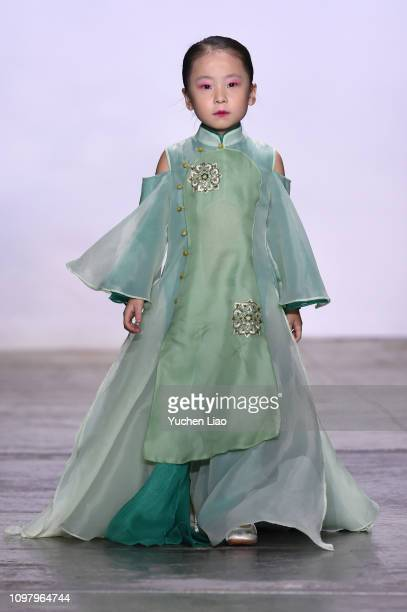 A model walks the runway for the Suncun fashion show during New York Fashion Week The Shows at Industria Studios on February 11 2019 in New York City