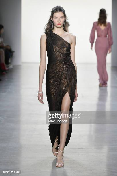 A model walks the runway for the Tadashi Shoji FW'19 Fashion Show during New York Fashion Week The Shows at Gallery I at Spring Studios on February 7...