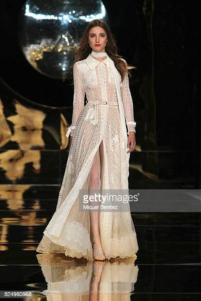 A model walks the runway for the YolanCris bridal collection during the 'Barcelona Bridal Fashion Week 2016' at Fira Montjuic on April 27 2016 in...