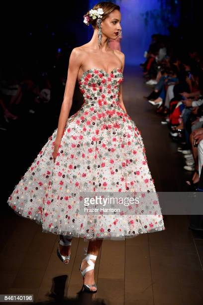 A model walks the runway for TRESemme at Naeem Khan NYFW SS18 on September 12 2017 in New York City