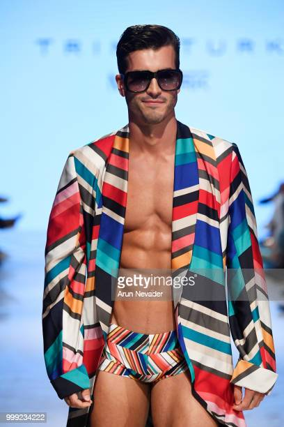 A model walks the runway for Trina Turk at Miami Swim Week powered by Art Hearts Fashion Swim/Resort 2018/19 at Faena Forum on July 14 2018 in Miami...