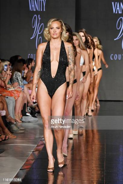 Model walks the runway for VANITY COUTURE At Miami Swim Week Powered By Art Hearts Fashion Swim/Resort 2019/20 at Faena Forum on July 11, 2019 in...