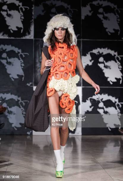 A model walks the runway for VIN OMI AW18 show on February 15 2018 in London England