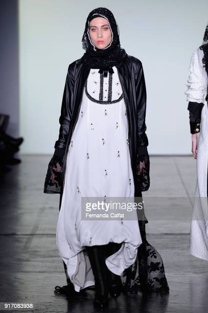 A model walks the runway for Vivi Zubedi during New York Fashion Week The Shows at Industria Studios on February 11 2018 in New York City