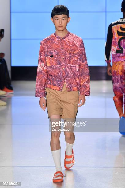 A model walks the runway for Wood House Army during July 2018 New York City Men's Fashion Week at Cadillac House on July 10 2018 in New York City