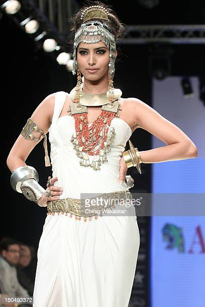 A model walks the runway in a Amrapali Jewellery design at the India International Jewellery Week 2012 Day 1 at the Grand Hyatt on on August 19 2012...