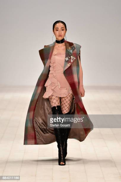 A model walks the runway in a design by AKLE during The Innovators Fashion Design Studio show at MercedesBenz Fashion Week Resort 18 Collections at...