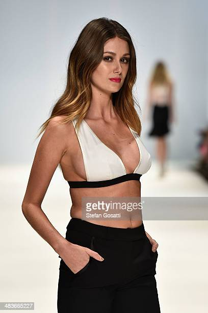 A model walks the runway in a design by Anna Quan at the New Generation show during MercedesBenz Fashion Week Australia 2014 at Carriageworks on...