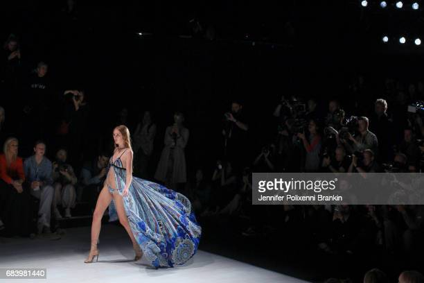 A model walks the runway in a design by Aqua Blu during the Swim show at MercedesBenz Fashion Week Resort 18 Collections at Carriageworks on May 17...