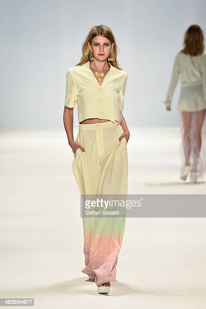 A model walks the runway in a design by Aquintic at the New Generation show during MercedesBenz Fashion Week Australia 2014 at Carriageworks on April...