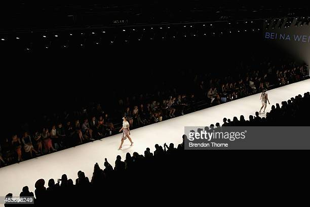 A model walks the runway in a design by Bei Na Wei at The Innovators show during MercedesBenz Fashion Week Australia 2014 at Carriageworks on April...