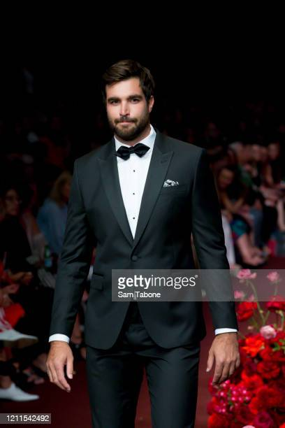 A model walks the runway in a design by Calibre during the Gala Runway 1 show at Melbourne Fashion Festival on March 10 2020 in Melbourne Australia